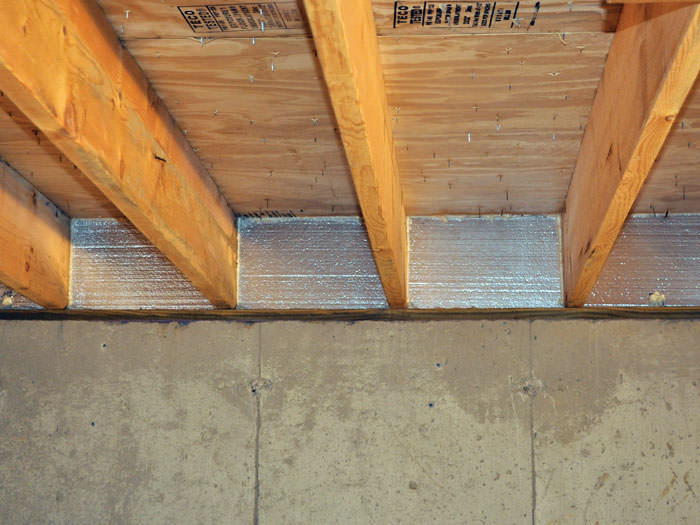 Silverglo Insulation Installed In A Floor Joist Orangeville