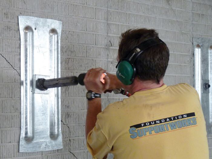 Wall straightening contractor vaughan markham mississauga mounting the steel wall plate for foundation wall repair and straightening in orillia solutioingenieria Choice Image