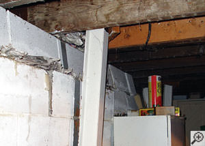 A failing foundation wall and i-beam support in a Toronto home