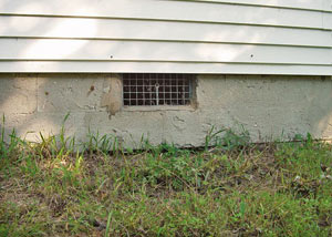Open crawl space vents that let rodents, termites, and other pests in a home in Caledon
