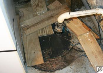 An ugly, clogged sump pump system in Richmond Hill, Ontario