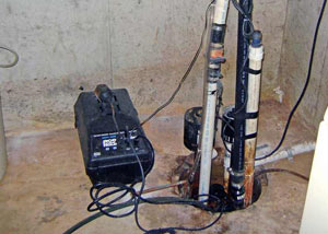 Pedestal sump pump system installed in a home in Ajax