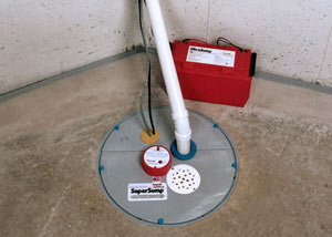 A sump pump system with a battery backup system installed in Bolton