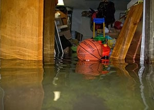 A flooded basement bedroom in Cambray