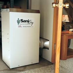 A basement dehumidifier with an ENERGY STAR® rating ducting dry air into a finished area of the basement  in Burnt River