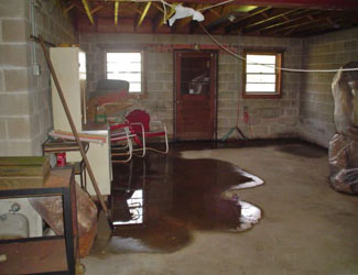 a flooded basement floor in a Burnt River home