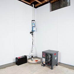 Sump pump system, dehumidifier, and basement wall panels installed during a sump pump installation in Ajax
